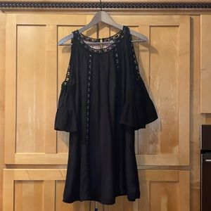 Open shoulder black shift dress